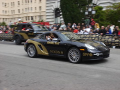 racing(0.0), convertible(0.0), auto racing(1.0), automobile(1.0), wheel(1.0), vehicle(1.0), performance car(1.0), automotive design(1.0), porsche(1.0), porsche cayman(1.0), race track(1.0), land vehicle(1.0), luxury vehicle(1.0), supercar(1.0), sports car(1.0),