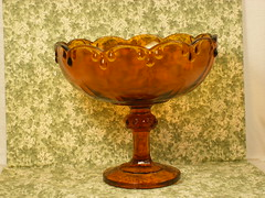 amber(0.0), wine glass(0.0), drinkware(0.0), ceramic(0.0), orange(1.0), brown(1.0), tableware(1.0), glass(1.0), antique(1.0), chalice(1.0),