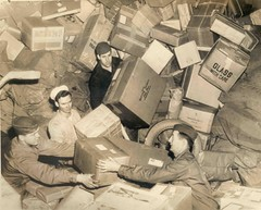 U.S. Troops Surrounded by Holiday Mail During WWII by Smithsonian Institution