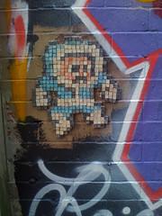 mosaic(0.0), modern art(0.0), art(1.0), wall(1.0), street art(1.0), painting(1.0), mural(1.0), graffiti(1.0),
