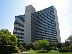brutalist architecture(0.0), tower(0.0), neighbourhood(0.0), tower block(1.0), metropolitan area(1.0), building(1.0), skyscraper(1.0), commercial building(1.0), landmark(1.0), architecture(1.0), corporate headquarters(1.0), headquarters(1.0), residential area(1.0), condominium(1.0), facade(1.0), city(1.0), downtown(1.0),