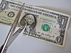 $1 bill Cut by Scissors