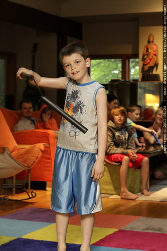 nick, demonstrating some flashy but suicidal nunchaku techniques to an audience of peers and parents
