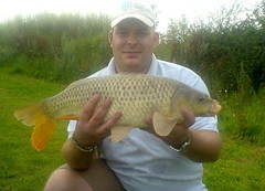 Paul with 9.2lb common on the island pool, caught on pellet.