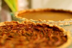 pastry(0.0), produce(0.0), pie(1.0), baked goods(1.0), pecan pie(1.0), food(1.0), dish(1.0), cuisine(1.0), quiche(1.0),