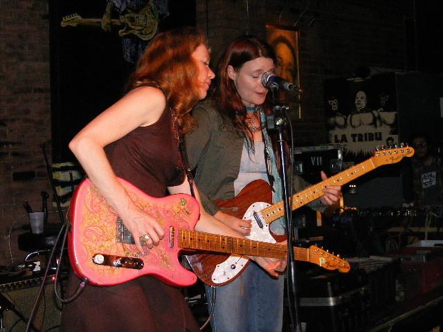 Guitar and woman sharing 10