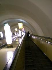 daylighting(0.0), subway(0.0), public transport(0.0), symmetry(1.0), light(1.0), architecture(1.0), escalator(1.0), infrastructure(1.0),