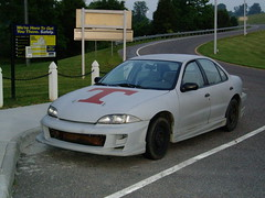 automobile, automotive exterior, family car, vehicle, chevrolet cavalier, compact car, bumper, sedan, land vehicle,