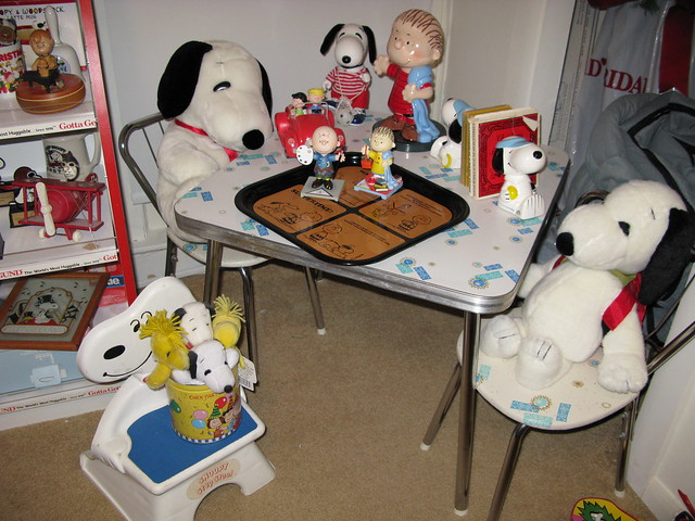 Snoopy Stuffed Animals sitting at child's formica table