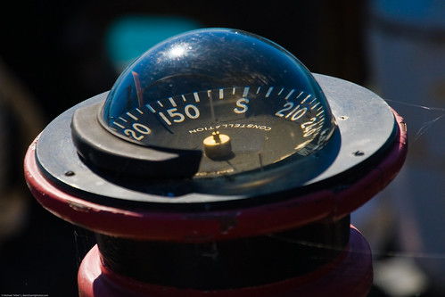 Compass on deck of derelict fishing ship