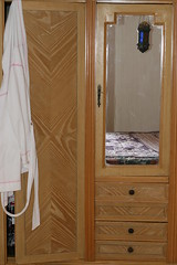 floor(0.0), door(0.0), closet(1.0), furniture(1.0), room(1.0), cupboard(1.0), wardrobe(1.0), cabinetry(1.0),