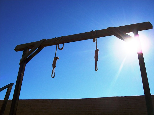Two hangman's nooses and gallows behind the courthouse in Tombstone, Arizona (tombstone14xy)