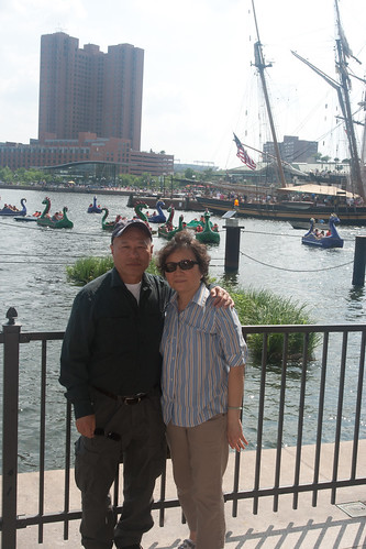Duc and Mai in front of the Dragon Boats