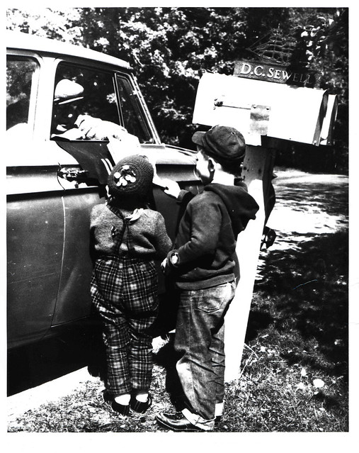 Rural Carrier Greeted by Children