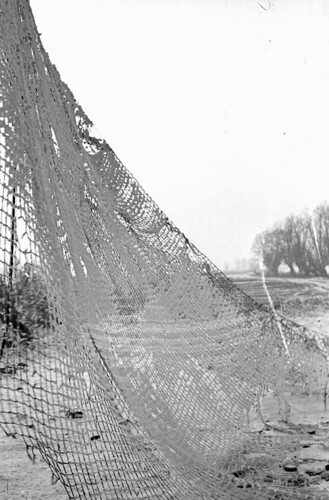 Snow on camouflage net 04