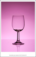 champagne(0.0), wine(0.0), red wine(0.0), drink(0.0), wine bottle(0.0), alcoholic beverage(0.0), wine glass(1.0), purple(1.0), violet(1.0), drinkware(1.0), stemware(1.0), tableware(1.0), glass(1.0), champagne stemware(1.0), pink(1.0),