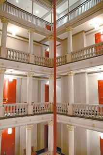 White Neo Classical Corridors with orange doors at the Hotel de la Paix Geneva Switzerland