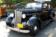 rolls-royce silver dawn(0.0), mid-size car(0.0), touring car(0.0), automobile(1.0), packard super eight(1.0), packard 120(1.0), vehicle(1.0), antique car(1.0), sedan(1.0), classic car(1.0), vintage car(1.0), land vehicle(1.0), luxury vehicle(1.0), motor vehicle(1.0),