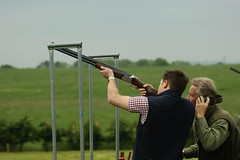 target archery(0.0), individual sports(1.0), shooting sport(1.0), shooting(1.0), clay pigeon shooting(1.0), sports(1.0), recreation(1.0), outdoor recreation(1.0), trap shooting(1.0), skeet shooting(1.0),