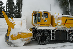 asphalt(0.0), tool(0.0), outdoor power equipment(1.0), winter(1.0), vehicle(1.0), transport(1.0), snow(1.0), snow removal(1.0), snowplow(1.0), snow blower(1.0), construction equipment(1.0), bulldozer(1.0),