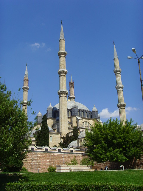 The Selimiye Mosque stands in the sun, against clear blue skies.