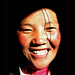 smiling-tibetan-girl-coming-out-darkb