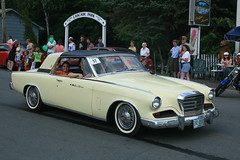 auto show(0.0), full-size car(0.0), mercedes-benz w111(0.0), automobile(1.0), automotive exterior(1.0), vehicle(1.0), automotive design(1.0), studebaker silver hawk(1.0), studebaker golden hawk(1.0), compact car(1.0), antique car(1.0), sedan(1.0), classic car(1.0), vintage car(1.0), land vehicle(1.0), luxury vehicle(1.0), convertible(1.0), motor vehicle(1.0),