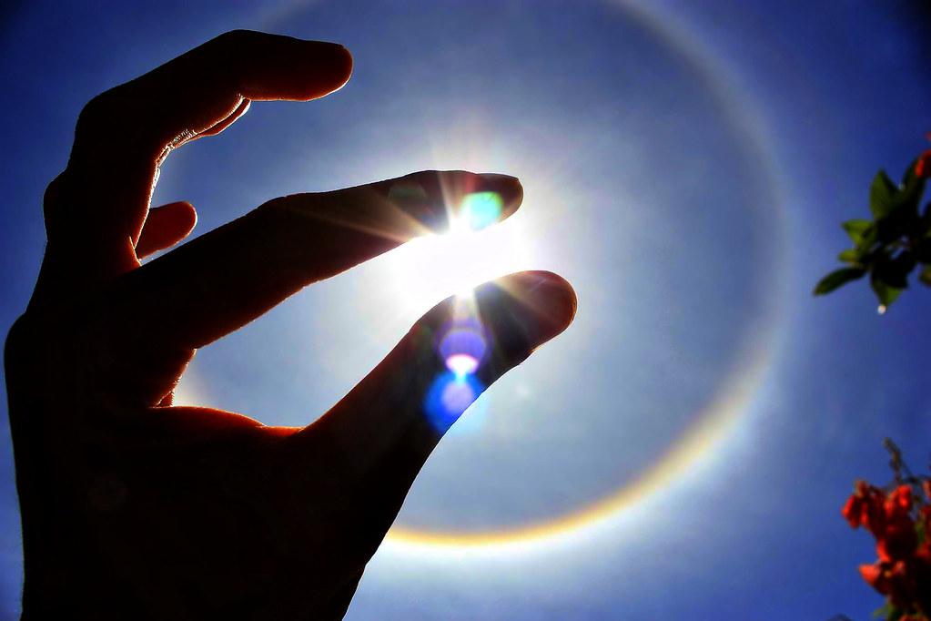 sun & ring & hand