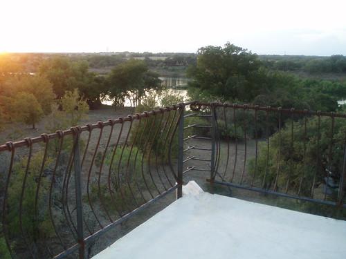 trees house tower landscape construction rocks iron texas view progress railing rebar marblefalls cottonwoodshores