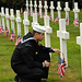 Sailor pays his respects to a fallen service member buried at the Brookwood American Cemetery and Memorial on Memorial Day