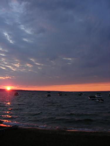 sunset sun lake water michigan burt
