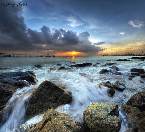 city longexposure morning travel light sunset sea sky people sun seascape color reflection tourism beach water clouds sunrise relax landscape happy dawn photo google search nikon singapore rocks asia exposure nightshot searchthebest rags famous culture visit photograph destination dri hdr stockphoto blending d700 bratanesque singaporelandscape singaporenightshot youstillnumberoneeeeeee singaporeseascape