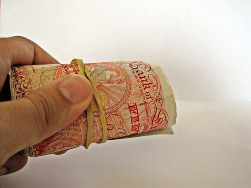 A roll of £50 notes