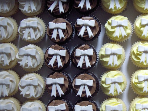 White Wedding Cupcakes Vanilla chocolate and lemon cupcakes all topped