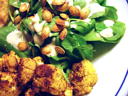 watercress with tahini dressing and pumpkin seeds; roasted golden cauliflower with sumac