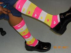 heel(0.0), arm(0.0), purple(0.0), high-heeled footwear(0.0), halter(0.0), human body(0.0), thigh(0.0), tights(0.0), outdoor shoe(1.0), footwear(1.0), yellow(1.0), shoe(1.0), limb(1.0), leg(1.0), sock(1.0), pink(1.0),