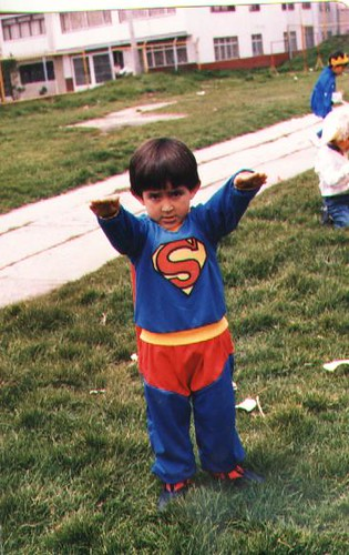 a child in a Superman costume