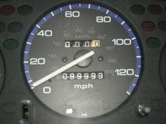automotive exterior(0.0), wheel(0.0), steering wheel(0.0), automobile(1.0), odometer(1.0), gauge(1.0), speedometer(1.0), tachometer(1.0),
