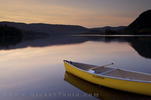 Canoe on lake at dusk at Lake Monroe Quebec Canada