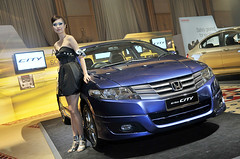 volkswagen cc(0.0), automobile(1.0), automotive exterior(1.0), executive car(1.0), family car(1.0), wheel(1.0), vehicle(1.0), automotive design(1.0), auto show(1.0), honda city(1.0), honda(1.0), sedan(1.0), land vehicle(1.0), luxury vehicle(1.0),