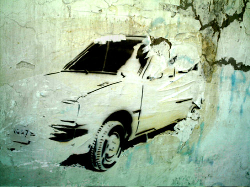 car in the wall