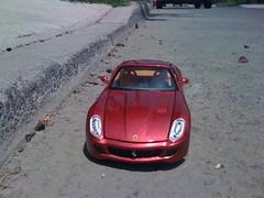 automobile(1.0), automotive exterior(1.0), ferrari 599 gtb fiorano(1.0), vehicle(1.0), performance car(1.0), automotive design(1.0), ferrari 612 scaglietti(1.0), bumper(1.0), ferrari s.p.a.(1.0), land vehicle(1.0), luxury vehicle(1.0), supercar(1.0), sports car(1.0),