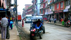 """""""Daily Commute"""" Typical Boudha street scene, with kids and a tractor used as a vehicle, Kathmandu, Nepal"""