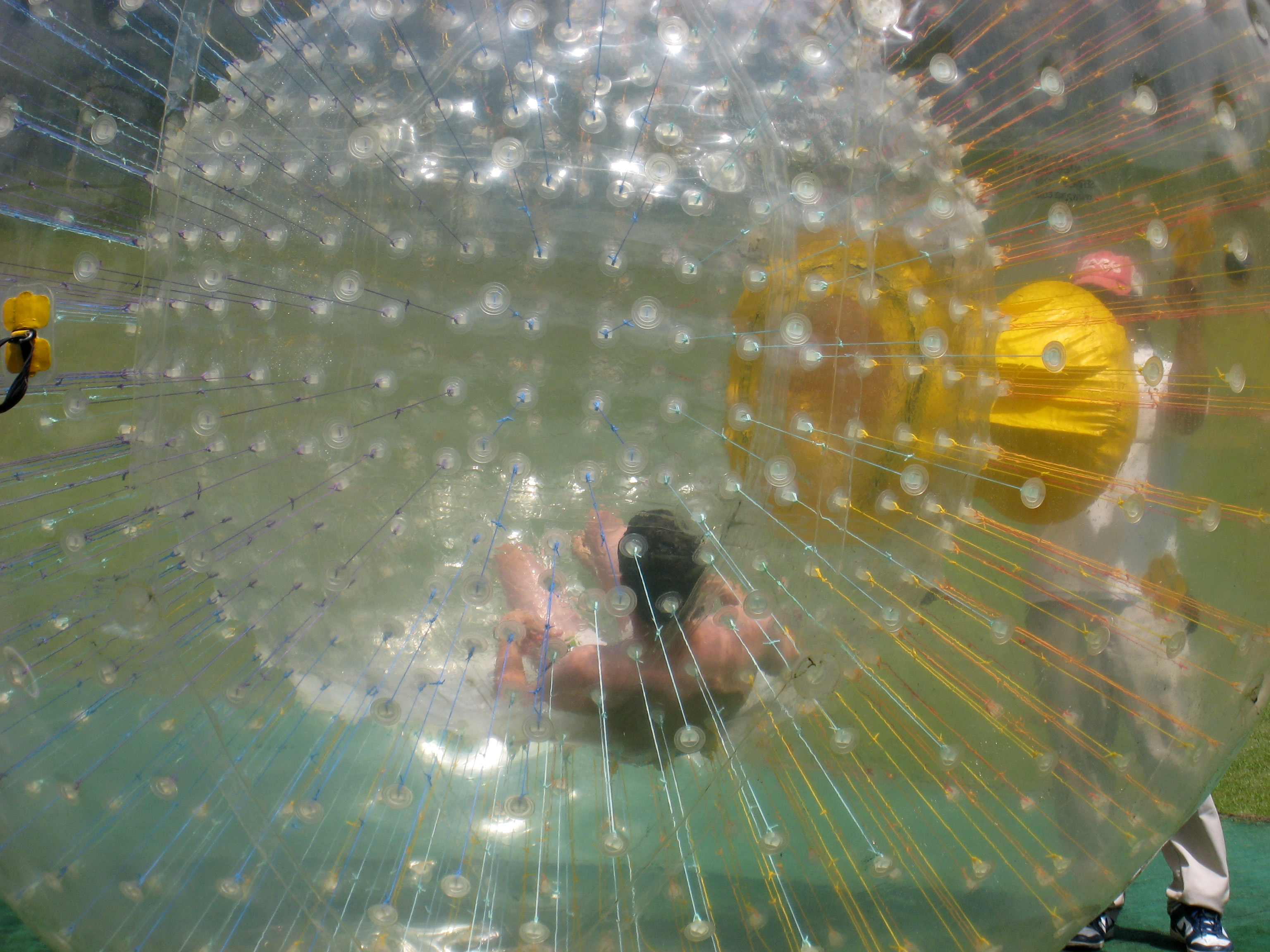 A man getting ready to zorb