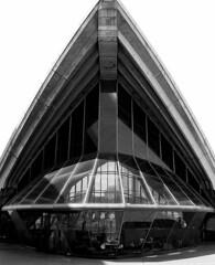 sport venue(0.0), hangar(0.0), stadium(0.0), dome(0.0), symmetry(1.0), landmark(1.0), architecture(1.0), monochrome photography(1.0), brutalist architecture(1.0), facade(1.0), monochrome(1.0), black-and-white(1.0),