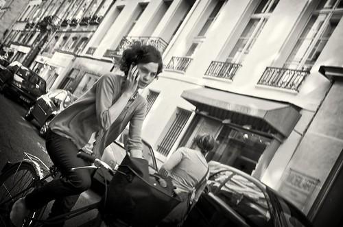 Parisian woman on a bike in paris