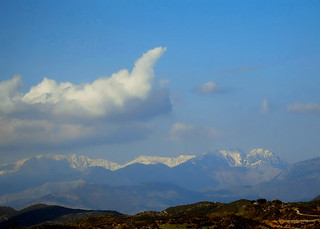 The mountain ranges of Erimanthos and Helmos ....