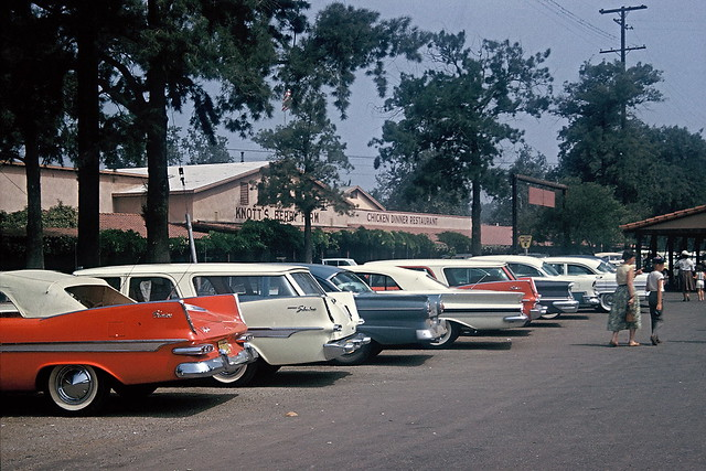 Cars with fins, parking lot at Knott's Berry Farm, 1960