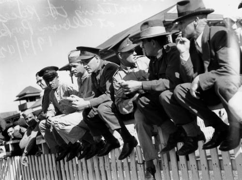 Soldiers sitting on the fence watching the races at Albion Park, Brisbane