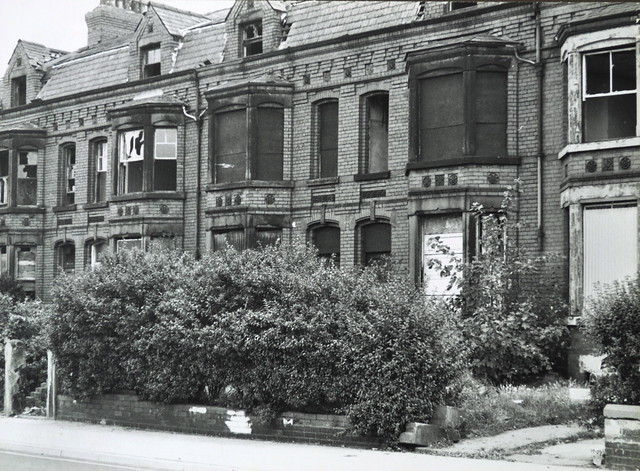 Documentary photograph showing a row of derelict terraced houses in Oriel Road, Bootle. Merseyside. England. United Kingdom. 1978.